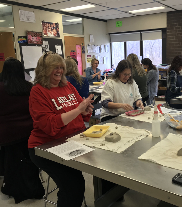 Staff having fun during professional development day in Ceramics class!