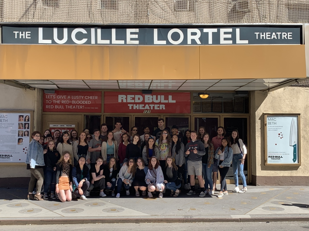Students pose outside the theater.
