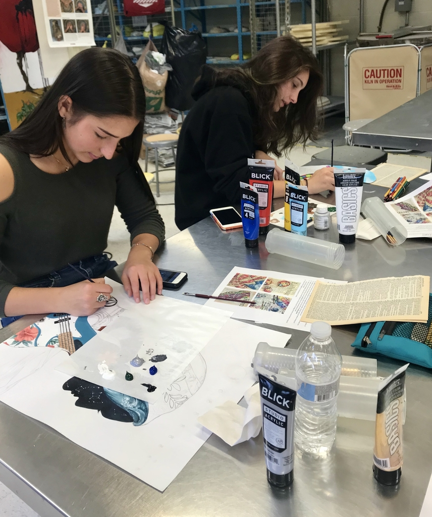 Studio Art students working diligently on their silhouette self portraits.