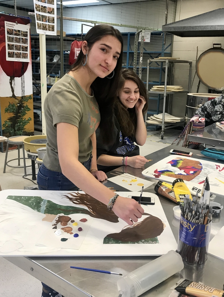 Studio Art students working on a playing card project based on a famous artist.